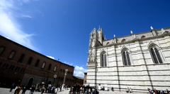 SIENA – APRIL 2016: Tourists near city cathedral. Siena is a major destination Stock Footage