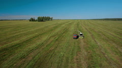 Aerial view of combain trailer harvesting silage Stock Footage