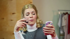 Drunk blonde chatting with her ex-boyfriend on cellphone, alcoholism, bad habits Stock Footage