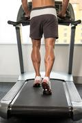 Close-up Exercising On A Treadmill - stock photo