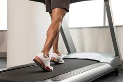 Close-up Exercising On A Treadmill Stock Photos