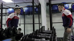 Strength training in the gym on simulators Stock Footage