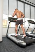Young Man On Treadmill Back View Stock Photos