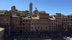 Stock Video Footage of SIENA – APRIL 2016: Tourists in Piazza del Campo. Siena is a major destination