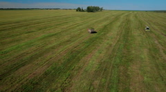 Aerial view of farmer harvesting silage Stock Footage