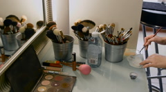 Table in a beauty salon. Professional brushes and powder boxes Stock Footage