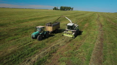 Aerial view of farmer harvester Stock Footage