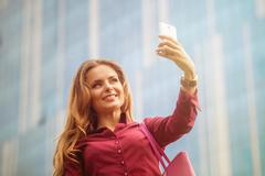 Businesswoman making selfies Kuvituskuvat