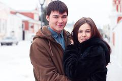 Young couple standing street in winter happy, smiling outdoors, the idea - stock photo