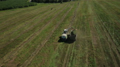 Aerial view of farmer combain and tractor Stock Footage