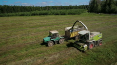 Aerial view of farmer combain and tractor in field Stock Footage