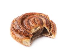 Bitten cinnamon roll bun isolated - stock photo