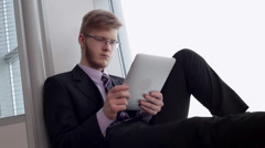View Business News on a Tablet Stock Footage