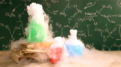 Dynamic chemical reaction in beakers, laboratory school Stock Footage