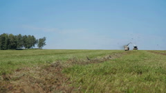 Farmer harvesting silage Combain in field Stock Footage