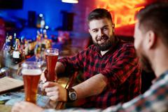 Sitting in pub - stock photo
