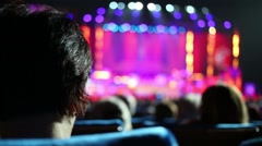 Nape of spectator watching action at award ceremony Fiddler on Roof Stock Footage