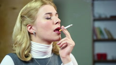 Blond woman smoking cigarette, coughing and drinking glass of wine. Bad habits Stock Footage