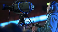 Operator with video camera records performances on stage Stock Footage