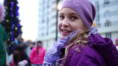 Girl in violet talking and smiling on playground in housing complex Stock Footage