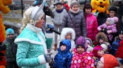 Snow Maiden with microphone in hand tells children Stock Footage