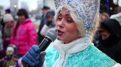 Snow Maiden close-up play with children on playground Stock Footage