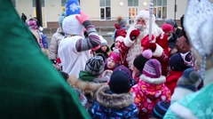 Snowman talking to Ded Moroz among children on playground Stock Footage