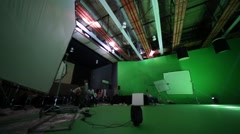 Panorama of film set with film crew and waiting girls on shooting video Stock Footage