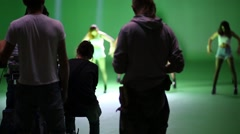 Film crew and behind dancing girls on shooting video. Stock Footage