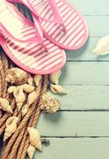 Summer concept with sandy beach, shells and cord. Stock Photos