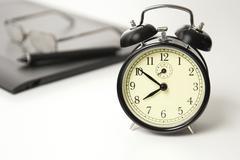 Alarm clock set to ten to eight, Time Concept - stock photo