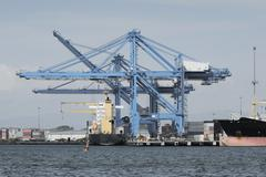 Large harbor cranes at the commercial dock in Panama city Stock Photos