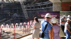 People look at reconstruction plan at viewing platform in Luzhniki Stock Footage