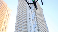 Quadrocopter DJI Inspire bouncing into air among houses. Stock Footage