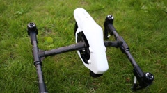 Quadrocopter DJI Inspire lowering body on legs and diode flashing Stock Footage