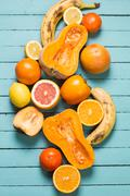 A selection of various fresh yellow raw organic produce fruits and vegetables - stock photo