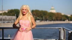 Girl in pink dress standing at handrail of ship sailing on river. Stock Footage