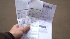 Documents and receipts of tax on transport in hand close up Stock Footage