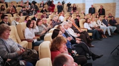People sitting in chairs in hall on VI online film festival Dubl dva Stock Footage