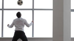 Businessman Joggling the Football Stock Footage