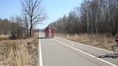 Fire truck with inscription AC 22 Moscow and woman on bicycle Stock Footage
