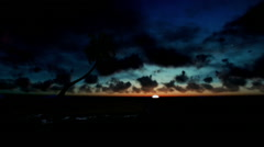 Tropical island with palm tree surrounded by ocean, beautiful timelapse sunrise - stock footage