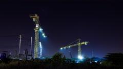 Crane working at night at construction site,Bangkok Stock Footage