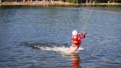 Girl pulling on rope in water on wakeboard and she falling. Stock Footage