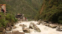 River Urubamba in Peru in the village of aguas calientes (Machu Picchu city) - stock footage