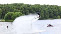 Sportsmen flyboard spinning in air and falling on celebration Stock Footage