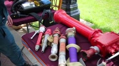 Pipes, tanks, gas masks and other equipment of firefighters on tables Stock Footage