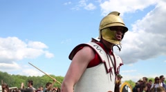 Man in helmet of gladiator putting sword on historical festival Stock Footage