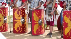 Shields and spears, swords of formation Roman soldiers close up. Stock Footage