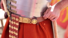 Dress, belt and plate armor Roman soldier close up. Stock Footage